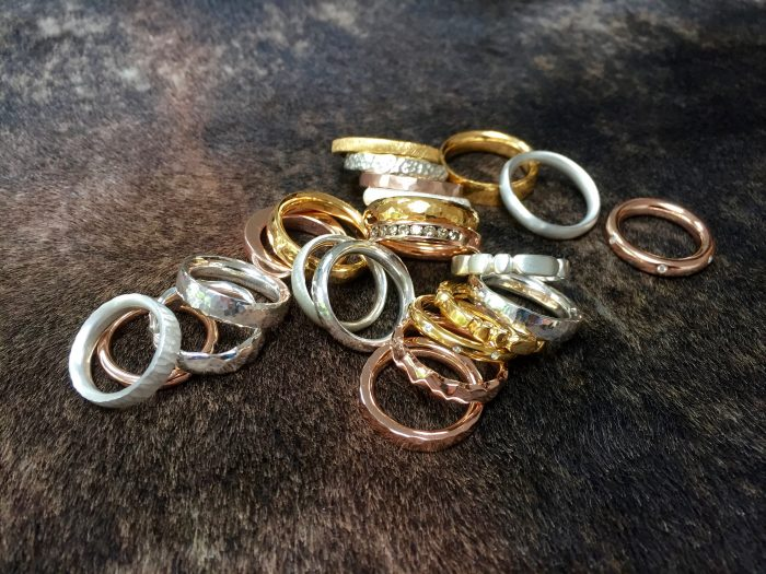 Tawny Phillips bespoke wedding rings in yellow, white and rose gold and platinum